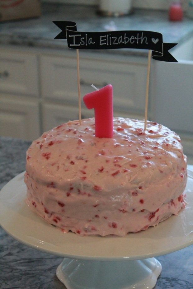 Pink strawberry first birthday cake